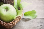 Green apple on wooden background — Stock Photo