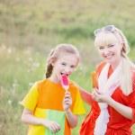 Happy family eating ice-cream outdoors — Stock Photo #73928547