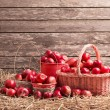 Red apples on wooden background — Stock Photo #74520611