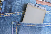 HTC Mobile Phone in a jeans pocket. — Stock Photo