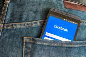 Mobile phone HTC and entrance to facebook — Stock Photo
