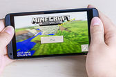 Minecraft computer game on smartphone — Stock Photo