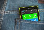 Nokia XL smartphone in the pocket of jeans  — Stock Photo