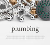 All kinds of plumbing and tools on a gray background — Stock Photo
