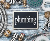 Plumbing and aktsessoryes on wooden table   — Stock Photo