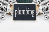 Plumbing and a blackboard with the text   — Stock Photo