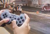 Teen plays race on Playstation — Stock Photo