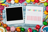Photoframe lies on sweets and candies — Foto Stock