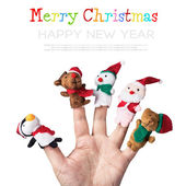 Christmas toys put on a hand — Stock Photo