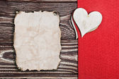 Heart carved from wood and old paper — Foto de Stock