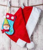 Christmas stocking and Santa hat — Stock Photo