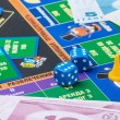 Постер, плакат: Monopoly game on table