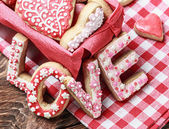 Baked cookies with love inscription — Stock Photo
