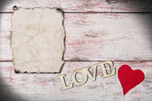 Old paper background with heart — Stockfoto