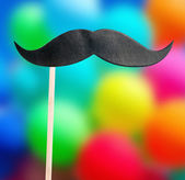 Paper holiday mustache — Stock Photo