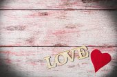 Love inscription on wooden background — Stock Photo