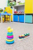 Childrens toys scattered on the floor — Stock Photo