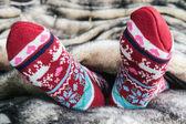 Female legs in Christmas socks — Stock Photo