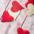 Felt and wooden hearts — Stock Photo #63723203