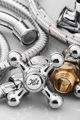 Plumbing and tools on a light background. — Stock Photo