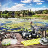 Fishing tackle on a wooden float — Stock Photo