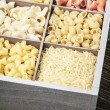 Pasta in a wooden box — Stock Photo #69403255