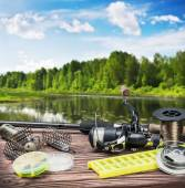 Fishing tackle and accessories on table — Stock Photo