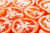 Slices of tomatoes background — Stock Photo