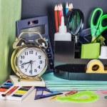 Alarm clocks and school supplies — Stock Photo #74583709