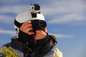 Snowboarder with camera — Stock Photo