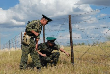 Russia, Saratov region, July 9, 2007. Border guards inspect the neutral zone on the Russian - Kazakhstan border in exercises to detain terrorists.