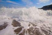 Beach waves sea surf foamy nearby — Stock Photo