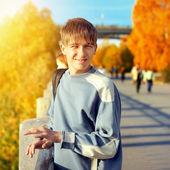 Teenager at Autumn Street — Stock Photo