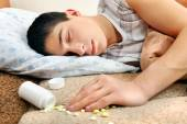 Teenager sleeps near the Pills — Stock Photo