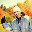 Young Man in the Autumn Park — Stock Photo #53911931