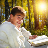 Boy with the Book outdoor — Stock Photo