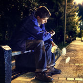 Teenager in the Night Park — Stock Photo
