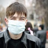 Teenager in Flu Mask — Stock Photo