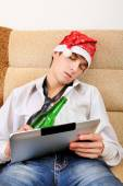 Teenager sleeping with a Beer and Tablet — Stock Photo