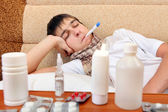 Sick Teenager with Thermometer — Stock Photo