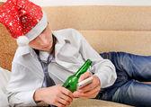 Drunken Teenager in Santa Hat — Stock Photo