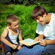 Brothers reads a Book — Stock Photo #58790831