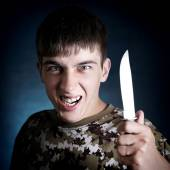 Angry Teenager with a Knife — Stock Photo