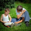 Teenager and Kid read a Book — Stock Photo #62042571
