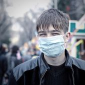 Teenager in the Flu Mask — Stock Photo