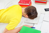 Tired Kid doing Homework — Stock Photo
