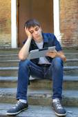 Sad Teenager with Tablet — Stock Photo