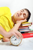 Tired Student sleep with Alarm Clock — Stock Photo