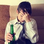 Sad Young Man with a Beer — Stock Photo