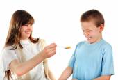 Sister feed a Little Brother — Stock Photo